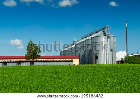 Farmland and silos for agricultural goods - stock photo