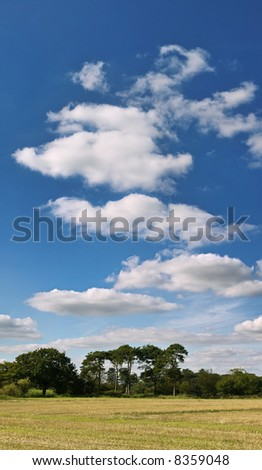farmland clouds trees ploughed earth soil agriculture