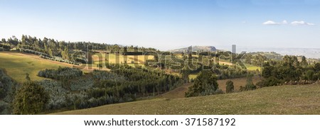 farmland, forest, and mountains in Ethiopian highlands, wide panorama - stock photo
