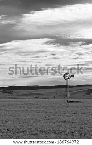 Farmland in America with Wind Pump  - stock photo