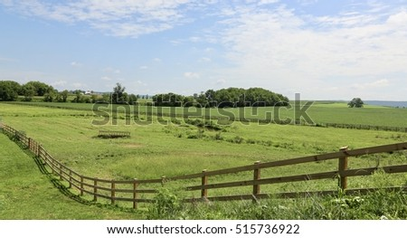 farmland with long winding fence