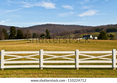 Farmland with White Fence Foreground - stock photo
