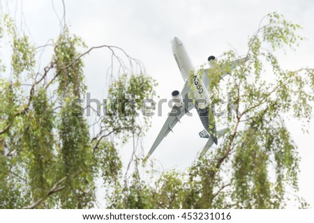 FARNBOROUGH, UK - JULY 13: Airbus A350-941 in a tight, low level turn just after take-off from Farnborough, Hampshire, UK on July 13, 2016 - stock photo