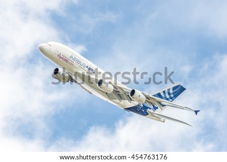 FARNBOROUGH, UK - JULY 16: Airbus A380 on a low-level banked turn prior to landing at an aviation trade event.Farnborough, UK on July 16, 2016 - stock photo