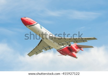 FARNBOROUGH, UK - JULY 14: Boeing 727 oil spill response aircraft operated by OSRL, taking-off from an aviation trade event in Farnborough, UK on July 14, 2016 - stock photo