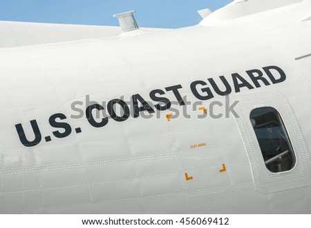 FARNBOROUGH, UK - JULY 15: Fuselage close-up of a maritime patrol aircraft operated by the US Coast Guard on display at Farnborough, UK on July 15, 2016 - stock photo