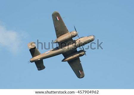 FARNBOROUGH, UK - JULY 17: Vintage B-25 Mitchell WW2 bomber aircraft in the skies over Farnborough, UK on July 17, 2016 - stock photo