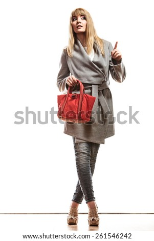 Fashion and advertisement concept.Full body woman elegant gray belt coat holding red handbag pointing copy space empty blank isolated - stock photo