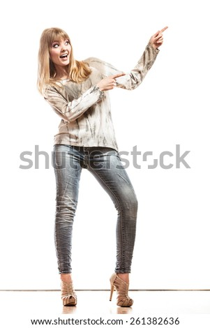 Fashion and advertisement concept. Full length woman pointing copy space empty blank isolated on white - stock photo