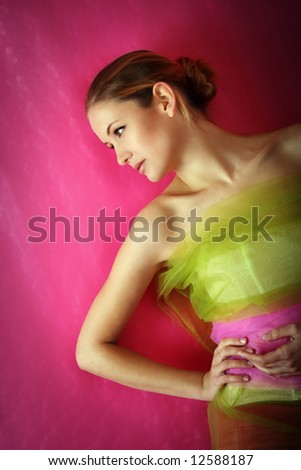 fashion and beauty portrait of a young woman in a dress - stock photo