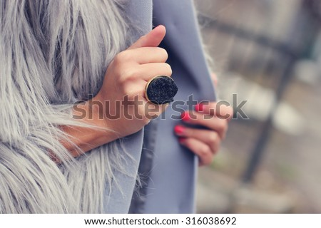 fashion and style girl holding her coat/manicured nails - stock photo