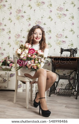 Fashion art photo of beautiful lady with flowers. Home interior.