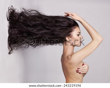 Fashion art photo of elegant naked lady with long healthy hair - stock photo