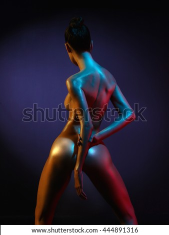 fashion art photo of sexy nude stripper in the night-club. Perfect female body  with oil skin - stock photo