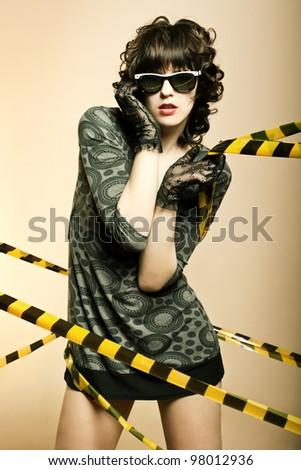 Fashion art portrait of a beautiful young sexy woman wearing sunglasses - stock photo