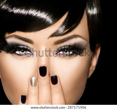 Fashion Art Portrait Of Beautiful Girl. Vogue Style Woman. Hairstyle. Black Hair and Nails. Isolated on Black Background. Beauty Stylish Model Portrait. Fringe haircut, hairstyle - stock photo