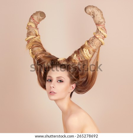 fashion art portrait of sexy beautiful woman with horns. Hairstyle concept girl - stock photo