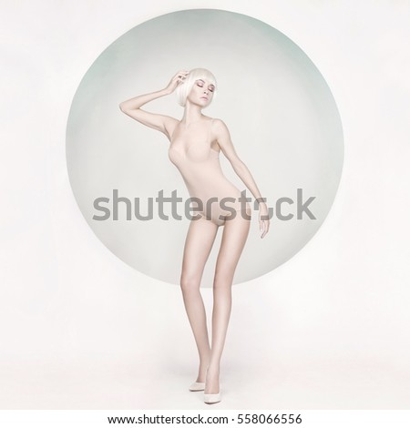 Fashion art studio photo of elegant sensual woman on geometric background