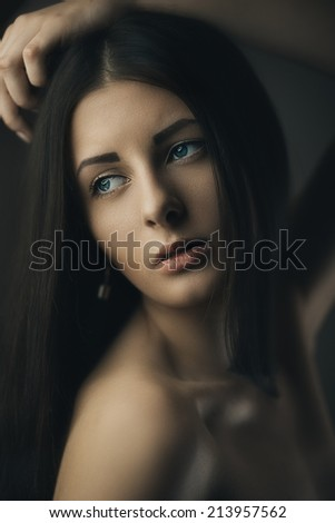Fashion artistic portrait of young brunette. Shallow depth of field - stock photo