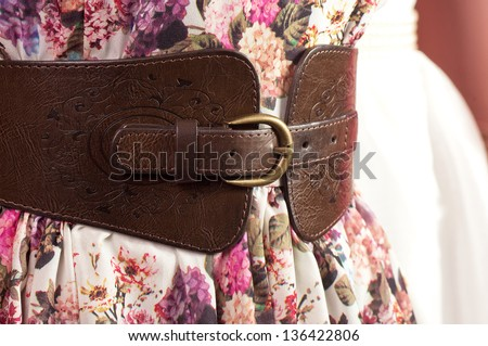 Fashion beautiful belt and dress on a mannequin - stock photo