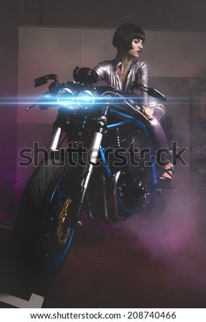 Fashion, Beautiful brunette woman wearing latex mounted on a motorcycle with a modern design - stock photo