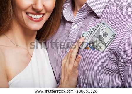 Fashion beautiful couple in love holding money the family budget. Business concept