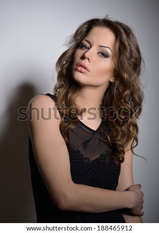 Fashion beautiful girl wearing black dress.