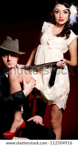 Fashion beautiful photo of man and woman in style Chicago gangster - stock photo
