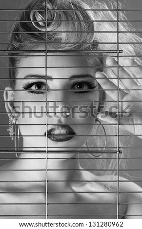 Fashion beautiful woman inside jail cell art portrait - stock photo