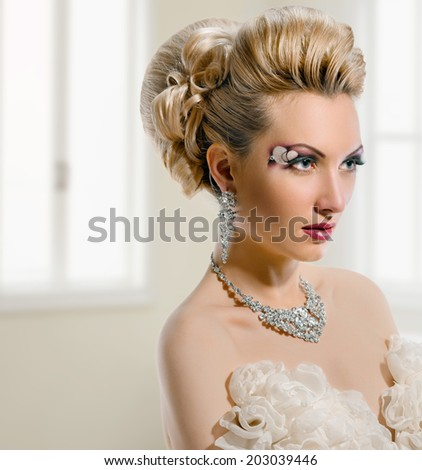 Fashion Beauty. Bride. Perfect Creative Make up and Hair Style. On window background