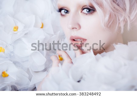 Fashion Beauty Model Girl in white Roses.  Bride. Perfect Creative Make up and Hairstyle.