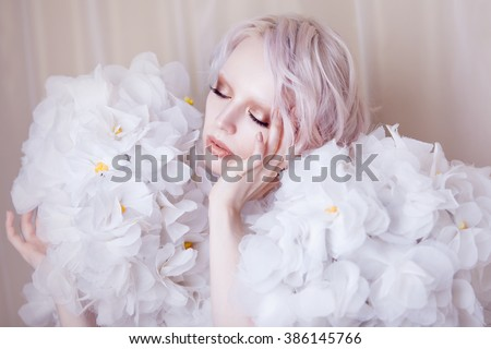 Fashion Beauty Model Girl in white Roses.  Bride. Perfect Creative Make up and Hairstyle.  - stock photo