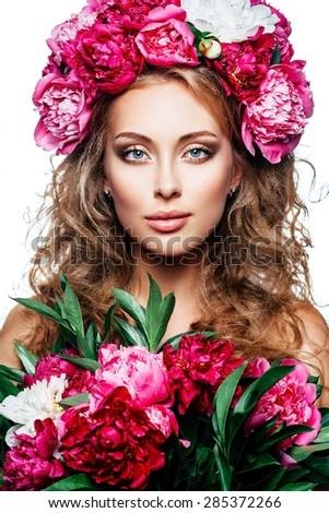 Fashion Beauty Model Girl with flowers in the hair. Bouquet of peonies. Perfect skin - stock photo