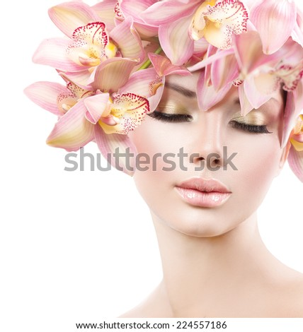 Fashion Beauty Model Girl with Orchid Flowers Hair. Spa woman. Bride. Perfect Creative Make up and Hair Style. Hairstyle. Nude makeup. Bouquet of Beautiful Flowers on lady's head  - stock photo