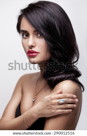 Fashion beauty portrait of a young beautiful attractive brunette girl with long black straight hair, red lips, in underwear. - stock photo