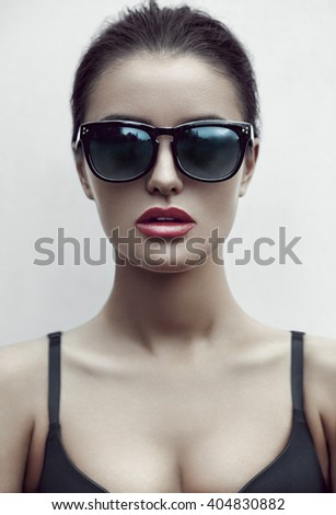 Fashion beauty portrait of beautiful brunette woman in sunglasses and underwear. Professional makeup.