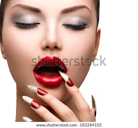 Fashion Beauty Sexy Model Girl. Manicure and Make-up. Nail art. Beautiful Woman With Red Nails and Lips. Luxury Makeup. Beautiful Girl Face and Hand close-up. Perfect Skin  - stock photo
