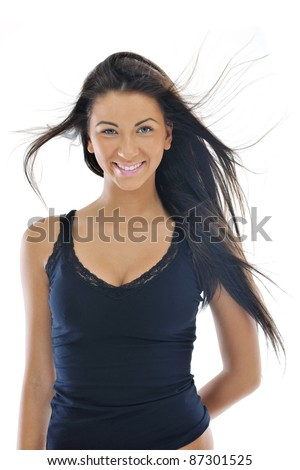 fashion beauty shoot with happy young girl isolated on white with wind in hair  in studio - stock photo