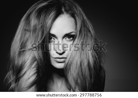 Fashion black and white portrait of young log hair woman.  - stock photo