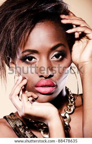 Fashion black woman wearing beautiful make-up - stock photo