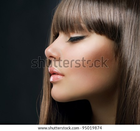 Fashion Blond Girl. Beautiful Makeup and Healthy Hair - stock photo