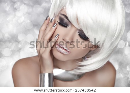Fashion Blond Girl. Smoky Eye makeup. Beauty Portrait Woman over bokeh Grey Background. White Short Hair. Isolated on Grey Background. Face Close-up. Hairstyle. Fringe. Vogue Style. - stock photo
