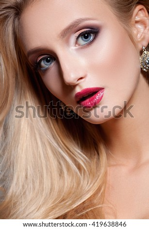 Fashion blonde woman with beautiful face and make-up. Skin care concept