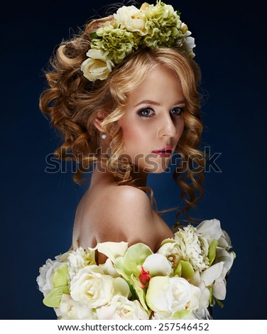 fashion blonde woman with curly hair in a hoop from flowers