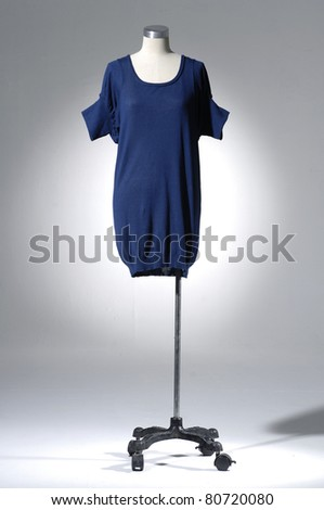 Fashion blue clothing on mannequin in light background