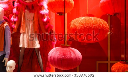 Fashion boutique/outlet windows display with mannequin and Chinese New Year red lantern decoration in an Asian shopping mall. Panoramic style - stock photo