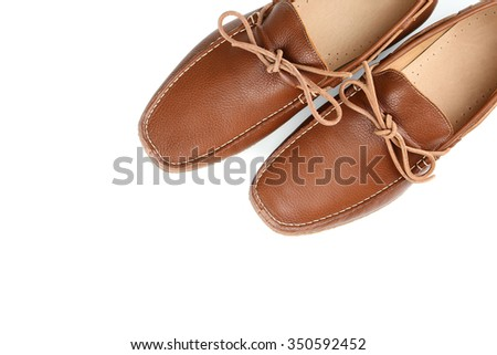 Fashion brown shoes on a white background
