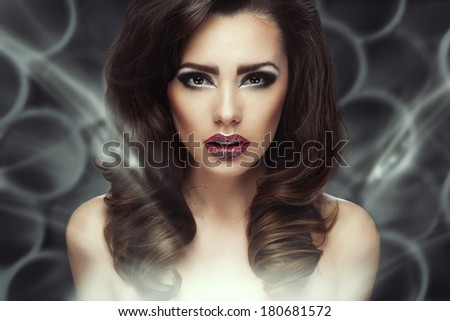Fashion Brunette . Beautiful Makeup and Healthy Black Hair - stock photo