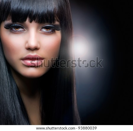 Fashion Brunette.Beautiful Makeup and Healthy Black Hair - stock photo