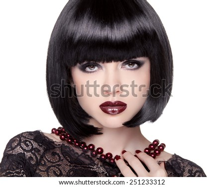 Fashion Brunette Girl model with Black bob hairstyle. Lady vamp. Woman with short Hair isolated on white studio background. - stock photo